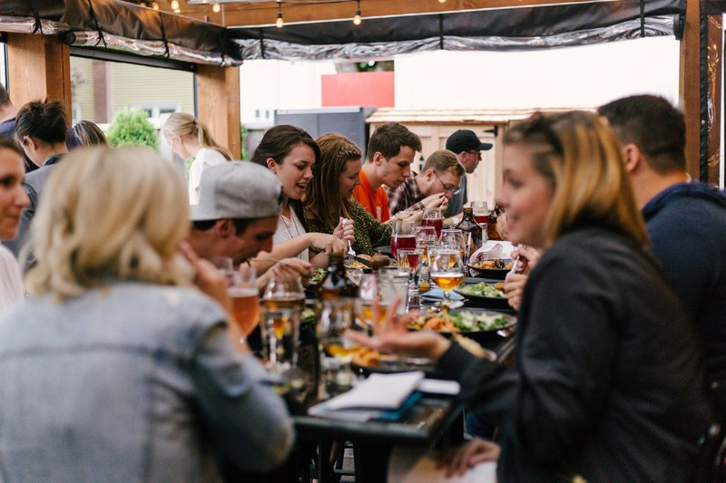 People eating a meal around a table